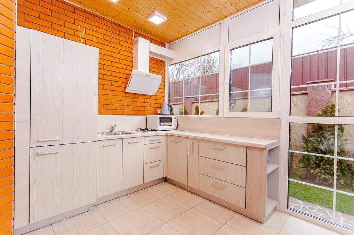 Orange Block Brick Wallled Kitchen