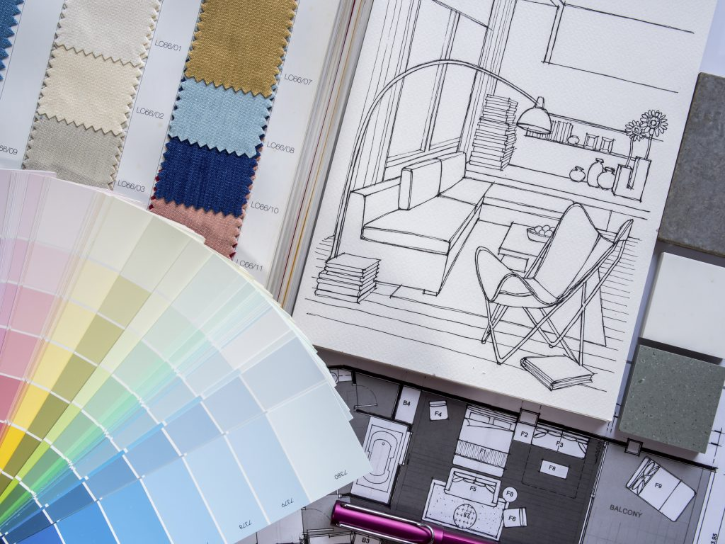 Paint and fabric samples with living room drawings