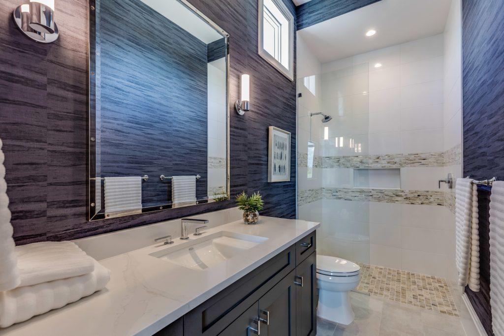 Modern faucet fixture and blue wallpaper
